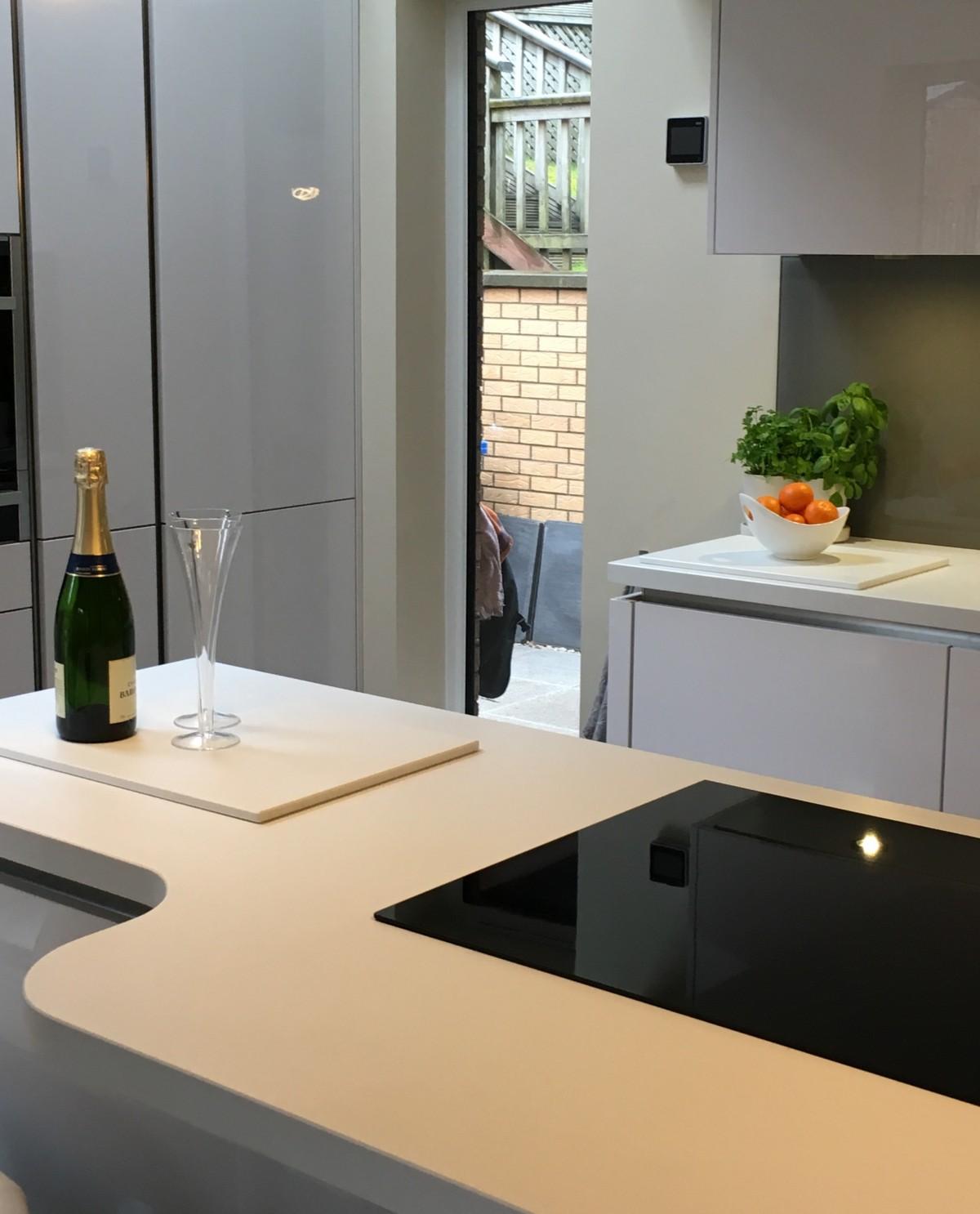 Modern German Kitchen With Corian Worktops & British